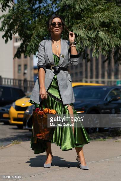 A guest is seen on the street attending New York Fashion Week SS19 wearing grey blazer with green dress and bouquet bag on September 6 2018 in New...