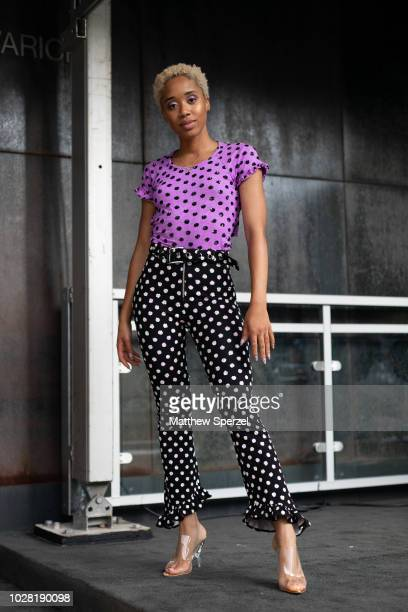 A guest is seen on the street attending New York Fashion Week SS19 wearing purple polka dot top with black/white polka dot pants on September 6 2018...