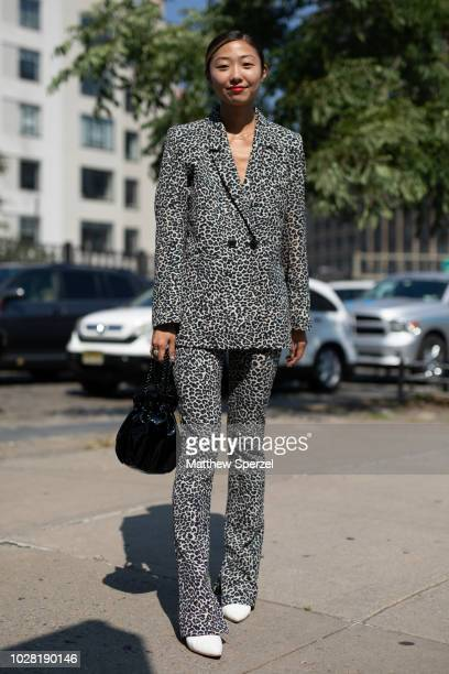 A guest is seen on the street attending New York Fashion Week SS19 wearing cheetah print suit on September 6 2018 in New York City