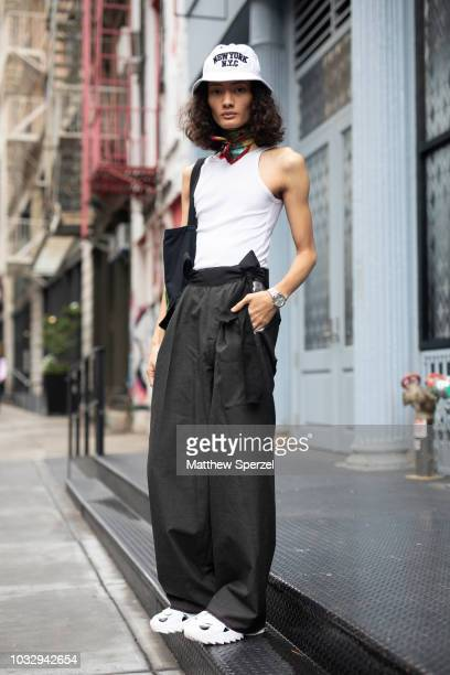 aa1c9e7c392 A guest is seen on the street attending New York Fashion Week SS19 wearing  white tank