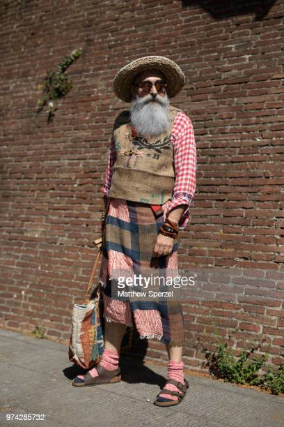 A guest is seen on the street attending Pitti Uomo 94 wearing a red plaid shirt with plaid skirt and red socks and Birkenstock sandals on June 12...