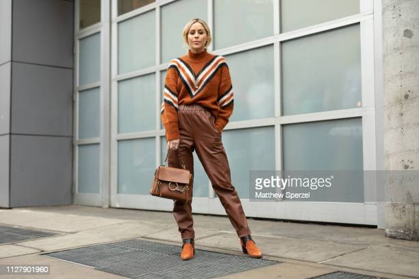 Guest is seen on the street attending Rachel Comey during New York Fashion Week wearing copper with stripes sweater, brown pants and bag, copper...