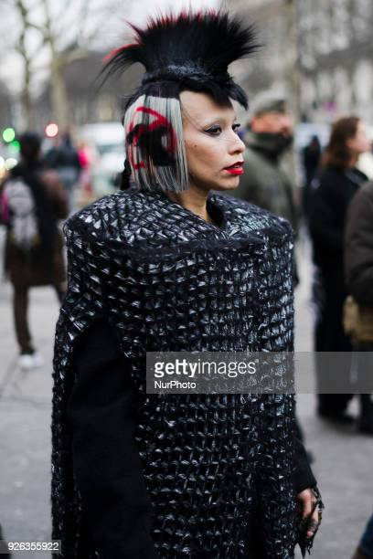 A guest is seen on the street attending Rick Owens during Paris Fashion Week Women's A/W 2018 Collection wearing an avant garde black/silver...