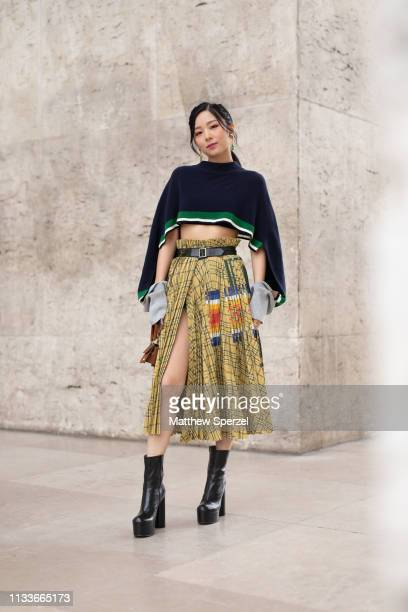 A guest is seen on the street attending SACAI during Paris Fashion Week AW19 wearing Sacai on March 04 2019 in Paris France