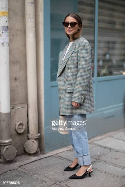 A guest is seen on the street attending Sacai during Paris Women's Fashion Week A/W 2018 wearing a tweed blazer with blue jeans on March 5 2018 in...