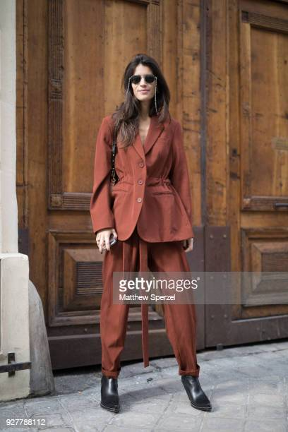A guest is seen on the street attending Sacai during Paris Women's Fashion Week A/W 2018 wearing a rust blazer and pants with black shoes on March 5...