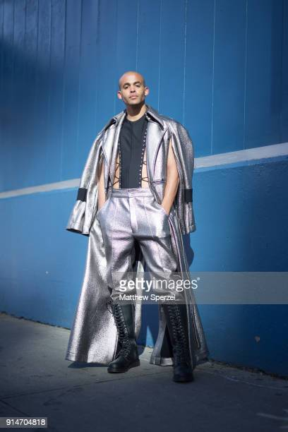 A guest is seen on the street attending SanchezKane and C2H4 Los Angeles during New York Fashion Week Men's wearing a metalic silver outfit with knee...