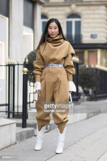 A guest is seen on the street attending Y/PROJECT during Paris Fashion Week Women's A/W 2018 Collection wearing Off White on March 1 2018 in Paris...