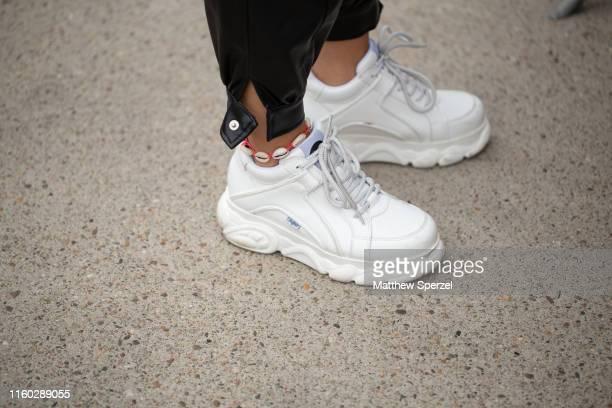 A guest is seen on the street during Berlin Fashion Week wearing Buffalo London sneakers on July 05 2019 in Berlin Germany