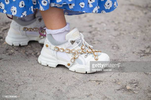 Guest is seen on the street during Berlin Fashion Week wearing white Gucci with rhinestones sneakers on July 05, 2019 in Berlin, Germany.