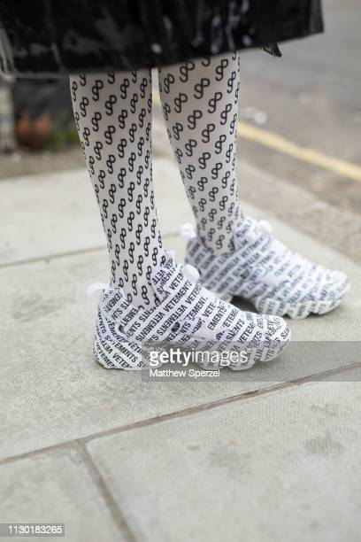 A guest is seen on the street during London Fashion Week February 2019 wearing Vetements sneakers on February 16 2019 in London England