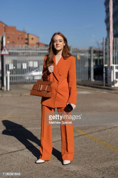 A guest is seen on the street during London Fashion Week February 2019 wearing Preen on February 17 2019 in London England