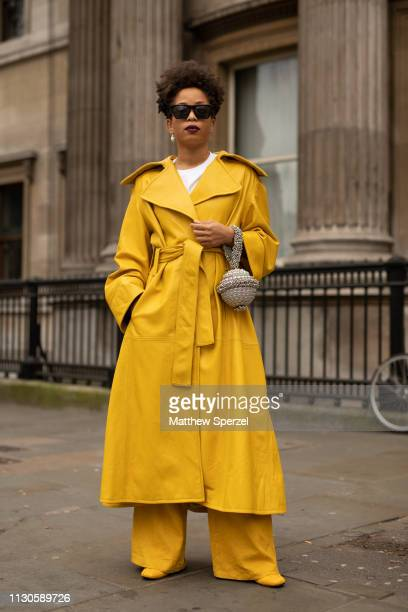 A guest is seen on the street during London Fashion Week February 2019 wearing ERDEM on February 18 2019 in London England