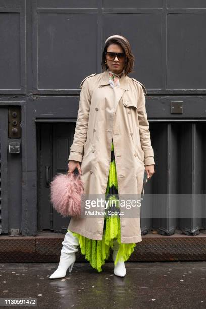 A guest is seen on the street during London Fashion Week February 2019 wearing REJINA PYO on February 18 2019 in London England