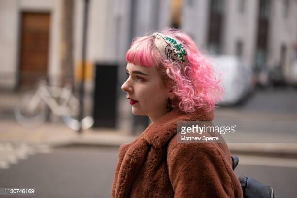 A guest is seen on the street during London Fashion Week February 2019 wearing head bandana on February 19 2019 in London England