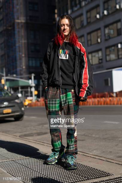 A guest is seen on the street during Men's New York Fashion Week wearing Alyx shirt red/black jacket green/brown plaid pants on February 05 2019 in...