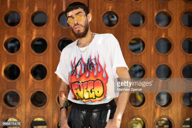 Guest is seen on the street during Men's New York Fashion Week wearing air brush 'Fuego' shirt with black pants on July 11, 2018 in New York City.