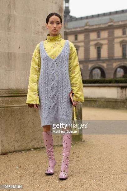 Guest is seen on the street during Men's Paris Fashion Week AW19 wearing grey knit dress, yellow shirt and pink boots on January 20, 2019 in Paris,...