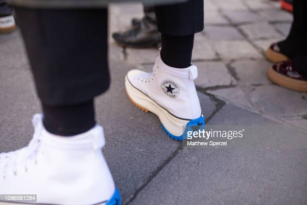 A guest is seen on the street during Men's Paris Fashion Week AW19 wearing Converse sneakers on January 19 2019 in Paris France