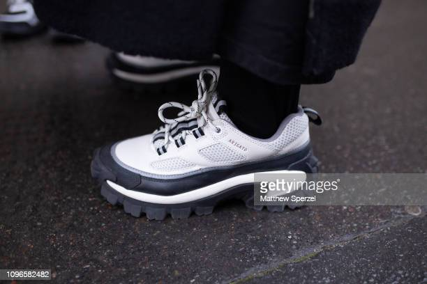 A guest is seen on the street during Men's Paris Fashion Week AW19 wearing Arigato sneakers on January 19 2019 in Paris France