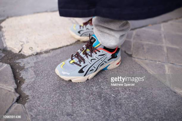 A guest is seen on the street during Men's Paris Fashion Week AW19 wearing Asics sneakers on January 19 2019 in Paris France