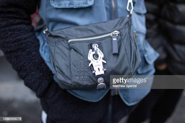 A guest is seen on the street during Men's Paris Fashion Week AW19 wearing George Gina Lucy bag on January 19 2019 in Paris France