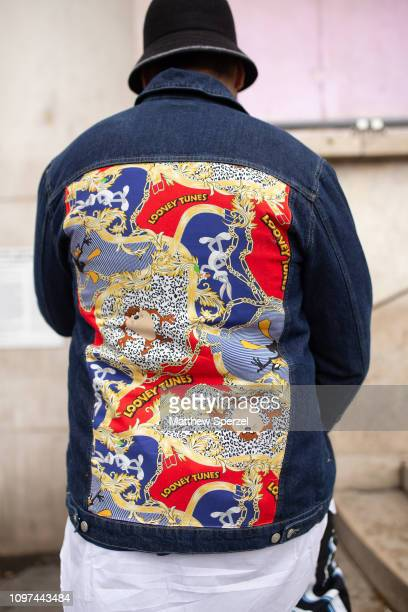 A guest is seen on the street during Men's Paris Fashion Week AW19 wearing Looney Tunes denim jacket on January 20 2019 in Paris France