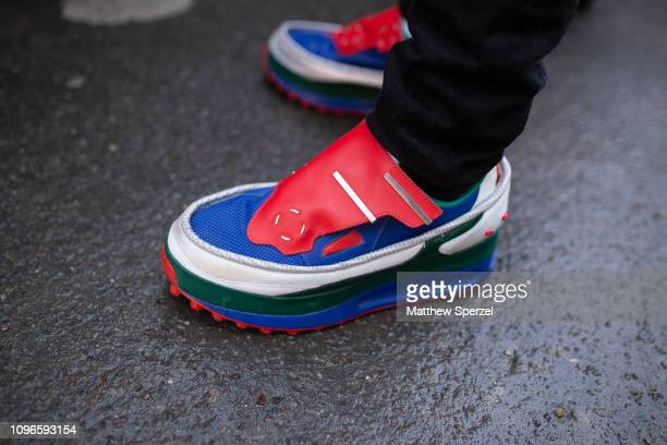 A guest is seen on the street during Men's Paris Fashion Week AW19 wearing Raf Simons x Adidas sneakers on January 19 2019 in Paris France