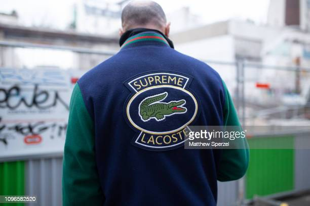 Guest is seen on the street during Men's Paris Fashion Week AW19 wearing Supreme x Lacoste jacket on January 19, 2019 in Paris, France.
