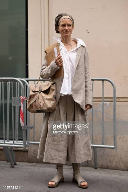 A guest is seen on the street during Men's Paris Fashion Week wearing Yohji Yamamoto on June 20 2019 in Paris France