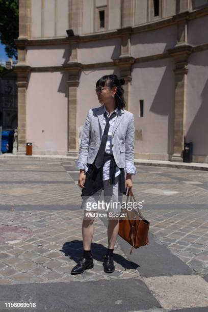 A guest is seen on the street during men's Paris Fashion Week wearing Thom Browne on June 22 2019 in Paris France