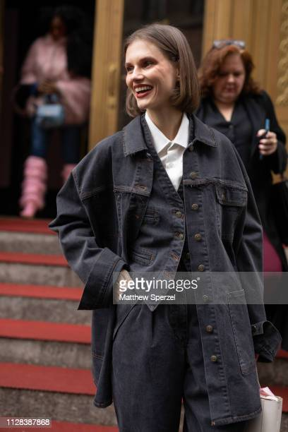 A guest is seen on the street during New York Fashion Week AW19 wearing black denim coat and vest with white shirt on February 08 2019 in New York...