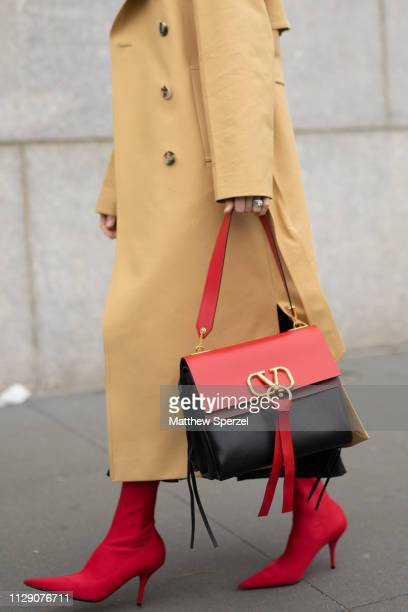 A guest is seen on the street during New York Fashion Week AW19 wearing Carolina Herrera with red bag and heels on February 11 2019 in New York City
