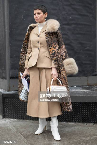 A guest is seen on the street during New York Fashion Week AW19 wearing leopard print with fur trim coat and khaki jacket and skirt on February 12...