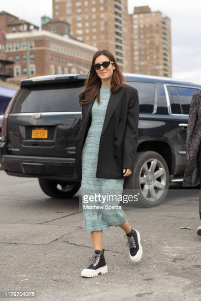 Guest is seen on the street during New York Fashion Week AW19 wearing BOSS on February 13, 2019 in New York City.