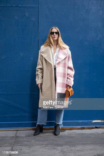 A guest is seen on the street during New York Fashion Week AW19 wearing Michael Kors on February 13 2019 in New York City