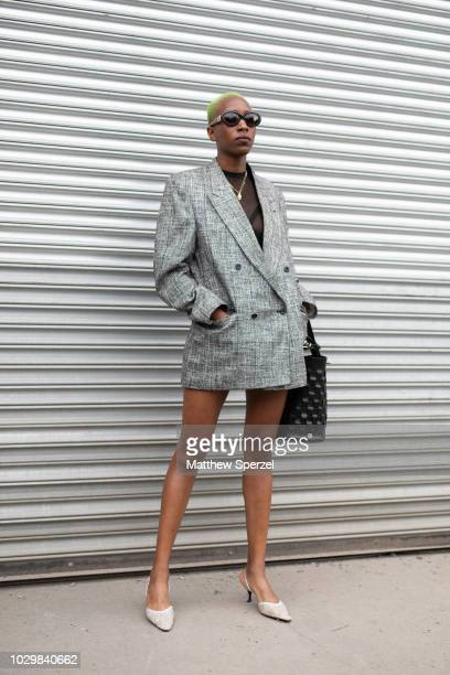 A guest is seen on the street during New York Fashion Week SS19 wearing grey blazer on September 8 2018 in New York City