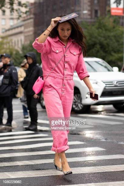 Guest is seen on the street during New York Fashion Week SS19 wearing pink jumpsuit on September 9, 2018 in New York City.