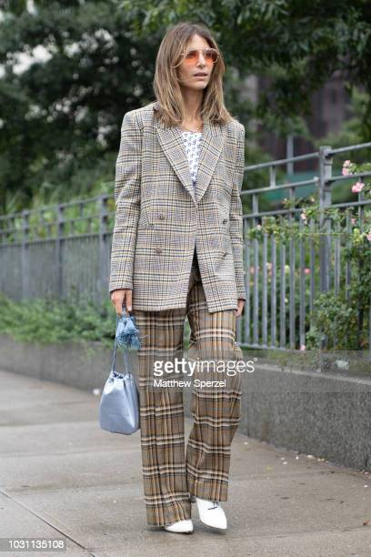 A guest is seen on the street during New York Fashion Week SS19 wearing plaid blazer with plaid pants on September 10 2018 in New York City