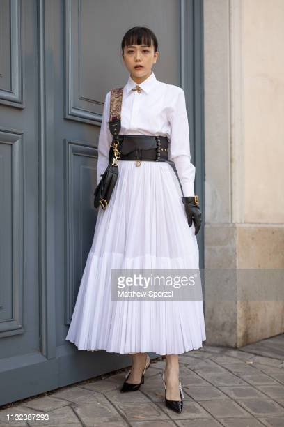 A guest is seen on the street during Paris Fashion Week AW19 wearing CHRISTIAN DIOR on February 26 2019 in Paris France