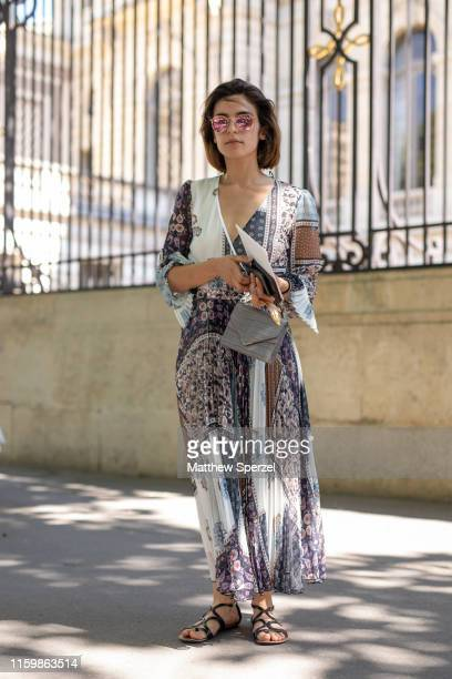 A guest is seen on the street during Paris Fashion Week Haute Couture wearing ZUHAIR MURAD dress on July 03 2019 in Paris France