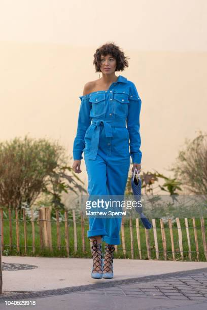 A guest is seen on the street during Paris Fashion Week SS19 wearing blue jumpsuit on September 25 2018 in Paris France