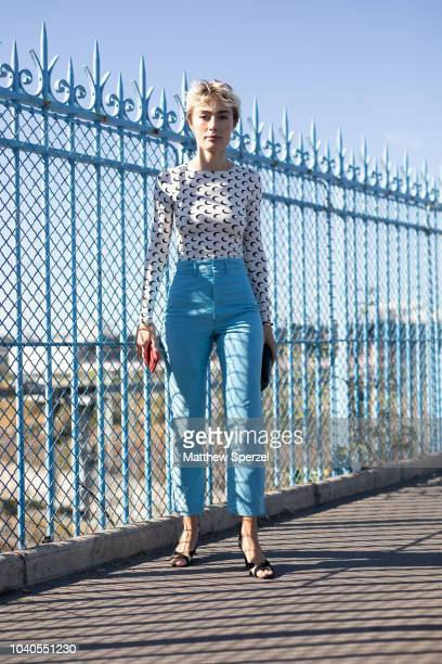 A guest is seen on the street during Paris Fashion Week SS19 wearing Marine Serre on September 25 2018 in Paris France