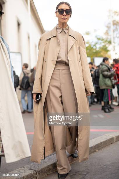 A guest is seen on the street during Paris Fashion Week SS19 wearing sacai on October 1 2018 in Paris France