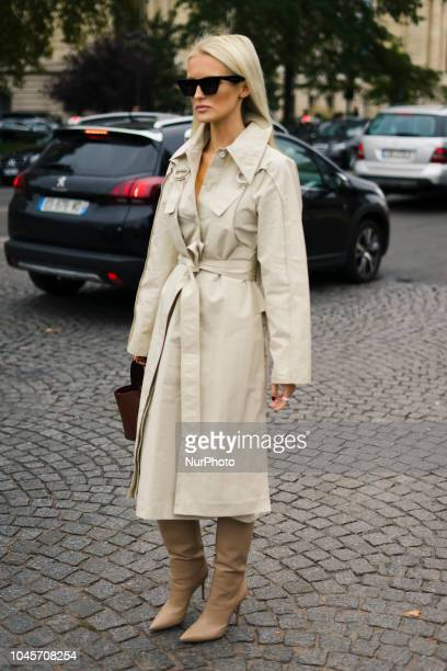 A guest is seen on the street during Paris Fashion Week SS19 wearing Chanel on October 2 2018 in Paris France
