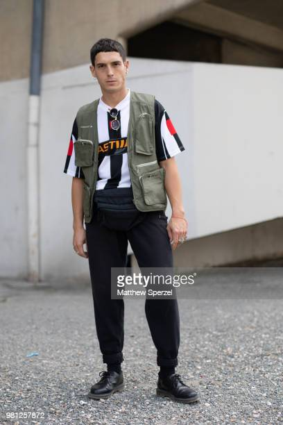 A guest is seen on the street during Paris Men's Fashion Week S/S 2019 wearing a green vest with black/white jersey on June 19 2018 in Paris France
