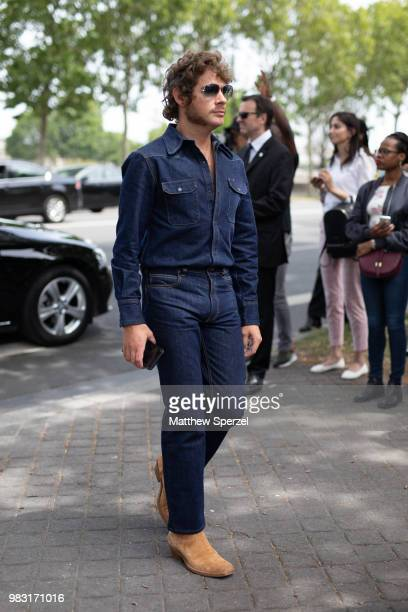A guest is seen on the street during Paris Men's Fashion Week S/S 2019 wearing a denim jumpsuit on June 24 2018 in Paris France