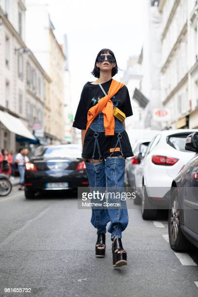 A guest is seen on the street during Paris Men's Fashion Week S/S 2019 wearing Heron Preston on June 22 2018 in Paris France