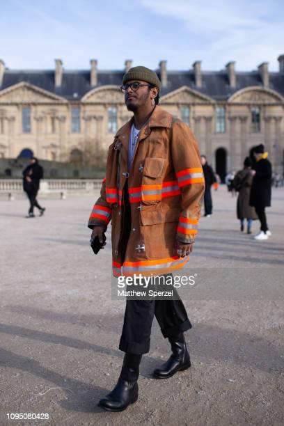 Guest is seen on the street during Paris Men's Fashion Week wearing Heron Preston coat on January 16, 2019 in Paris, France.
