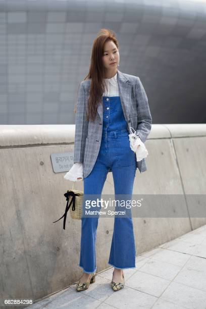 A guest is seen on the street wearing a white shirt blue denim pants grey plaid blazer during HERA Seoul Fashion Week on March 28 2017 in Seoul South...
